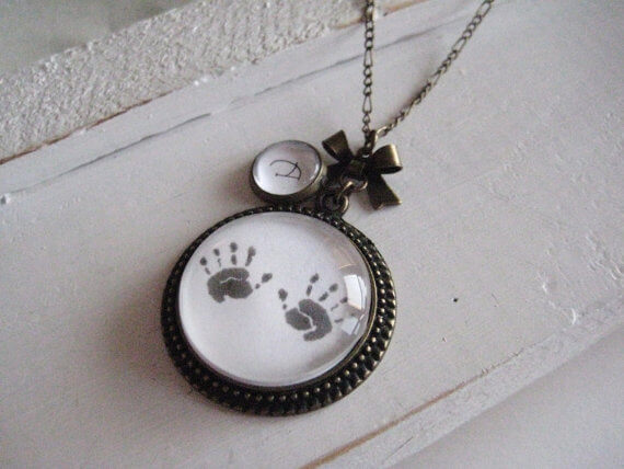 hand prints on a necklace for mother's day gift
