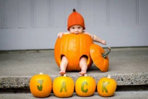 baby's first halloween pumpkin picture