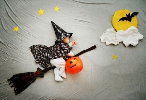 babies first halloween picture ideas witch on a broom